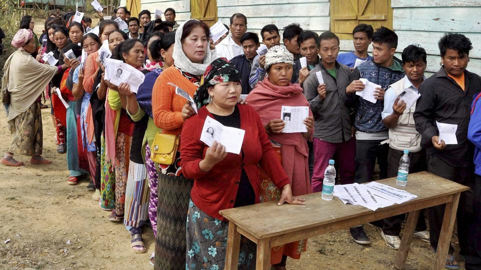 People stand in queues to cast their votes in Chandel constituency of Manipur during the last phase of state assembly elections on March 8.
