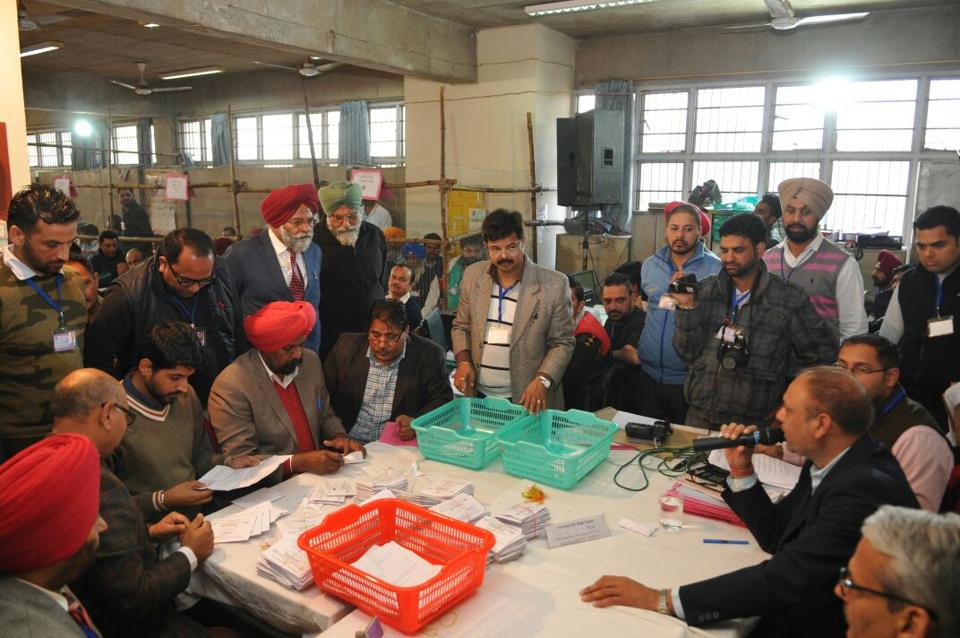 Ballot papers being counted in Jalandhar on Saturday.  (Pardeep pandit/ht)