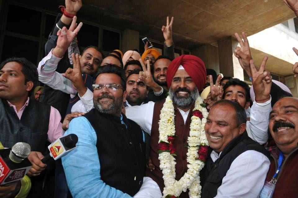 Pargat Singh celebrating his victory in Jalandhar.