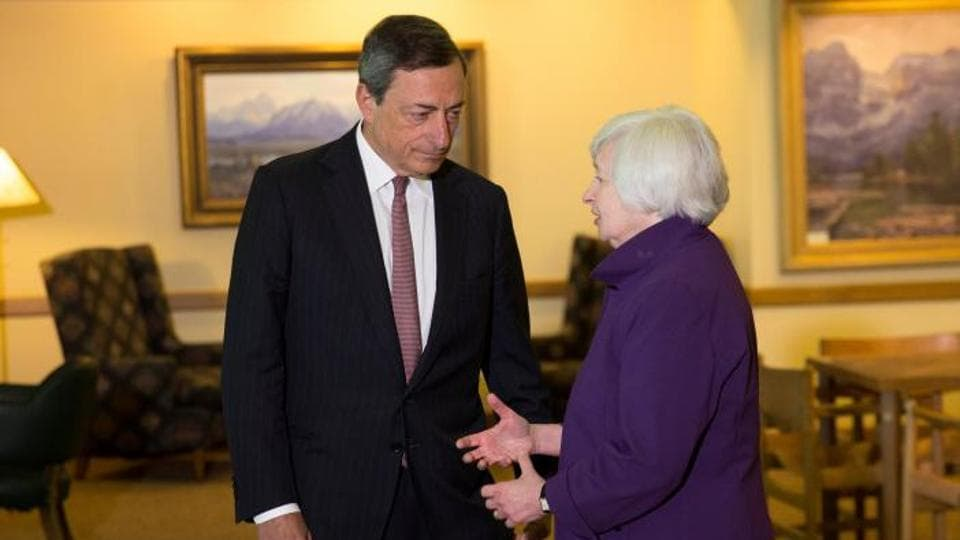 Fed chair Janet Yellen speaks to ECB president Mario Draghi at the Jackson Hole, Wyoming