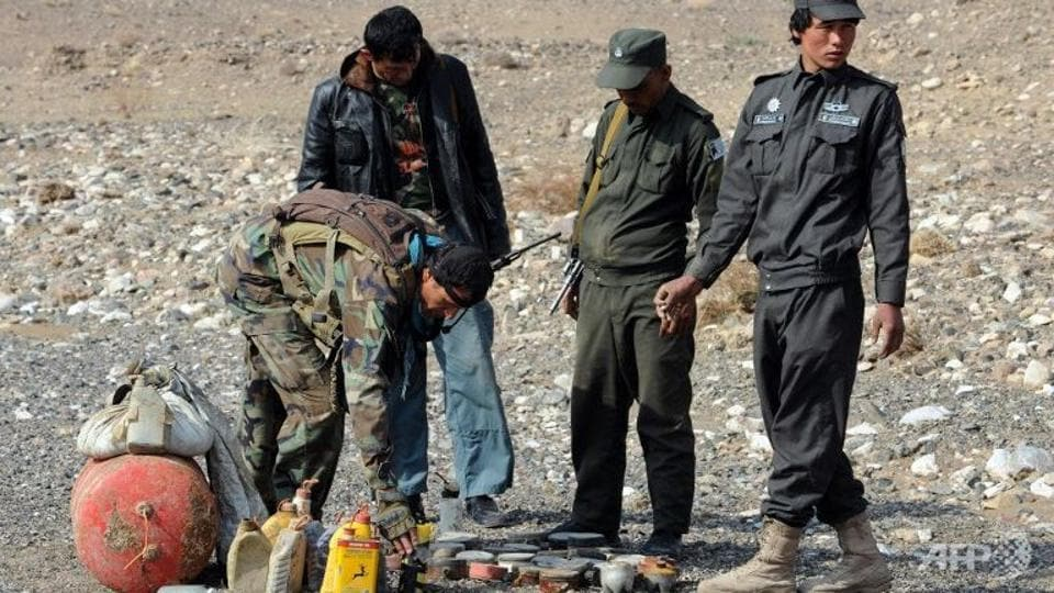"""Eight local policemen were killed by their colleagues after they were poisoned in their base in southern Afghanistan, officials said Saturday, in a latest so-called """"insider attack""""."""