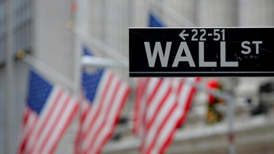 A street sign for Wall Street is seen outside the New York Stock Exchange (NYSE) in Manhattan, New York City