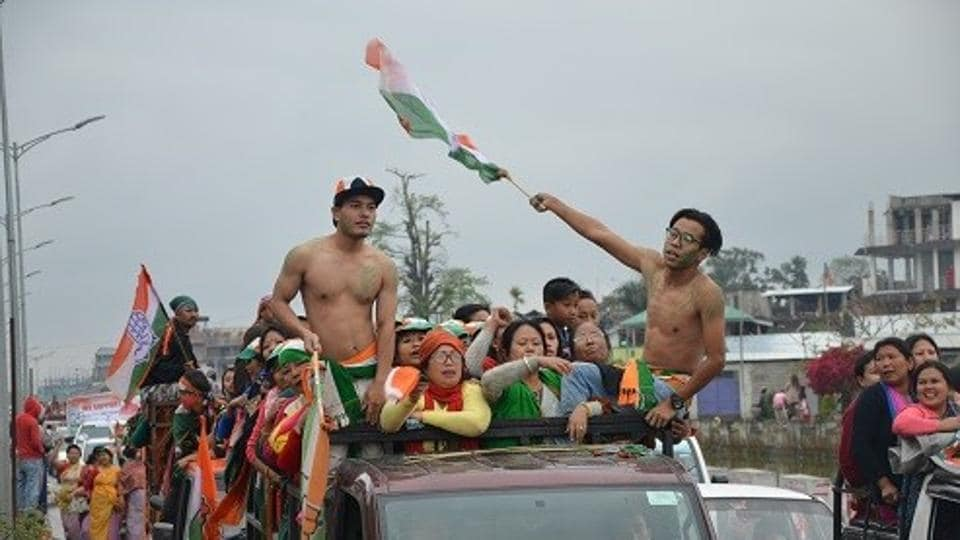 BJP supporters celebrate the party's strong  election show, in Imphal on Saturday.