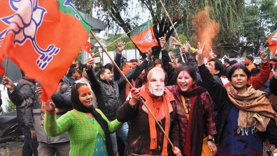 BJP workers celebrate their win in Uttarakhand.