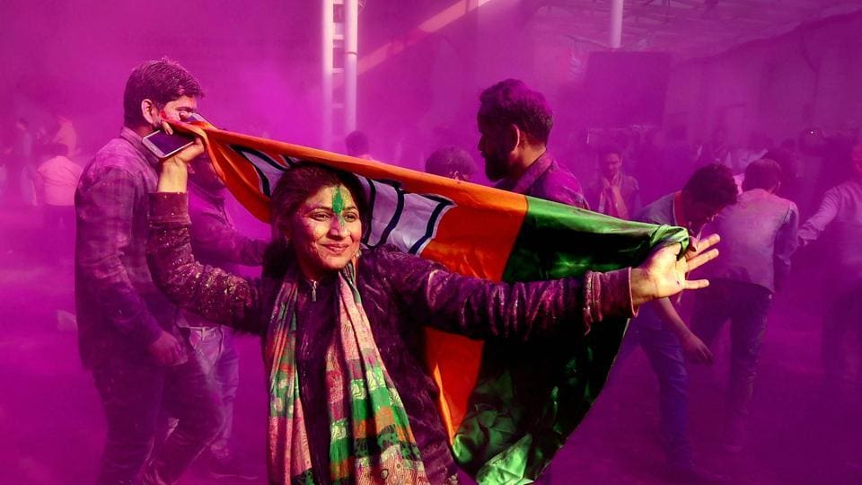 BJP supporters and workers play holi as they celebrate the party's victory in the UP and Uttarakhand assembly elections in New Delhi, March 11