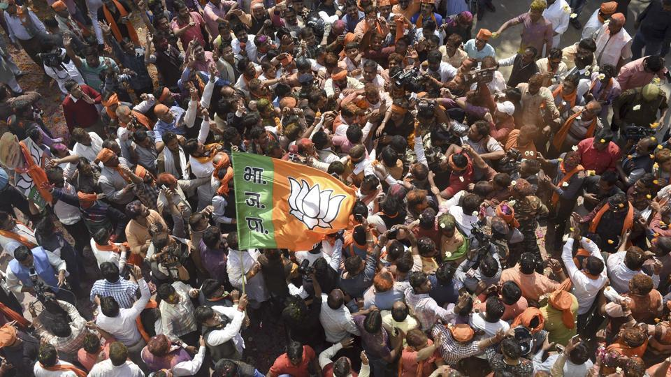 BJP Workers celebrates victory after election results at party office in Lucknow. (Arvind Yadav/HT PHOTO)
