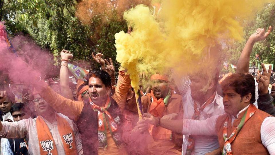 BJP supporters celebrate the party's Uttar Pradesh victory in New Delhi on Saturday.
