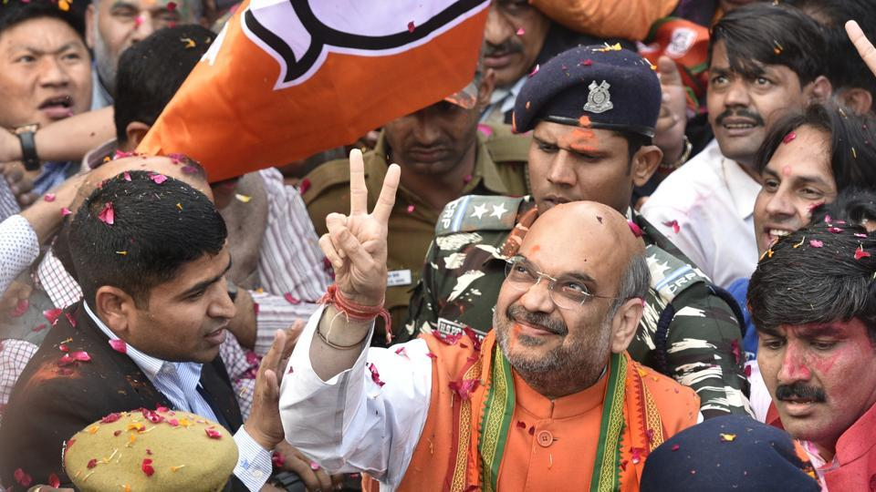 BJP president Amit Shah greets supporters and party workers after election results in New Delhi on Saturday.