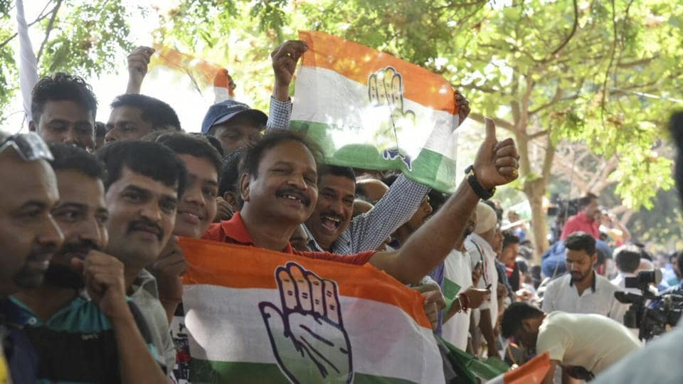 Congress party workers celebrate outside counting centre in Panjim, Goa.