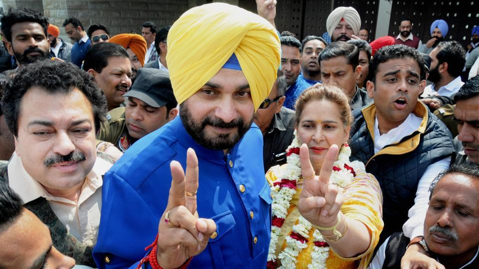 Congress candidate from Amritsar East assembly Navjot Singh Sidhu with his wife after he defeated BJP's district president Rajesh Honey and won the seat on Saturday.  (PTI)