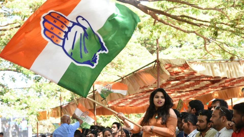 Congress workers wave flags in Panjim. The party has taken a lead in the state elections vote counting in Goa. (HT Photo)