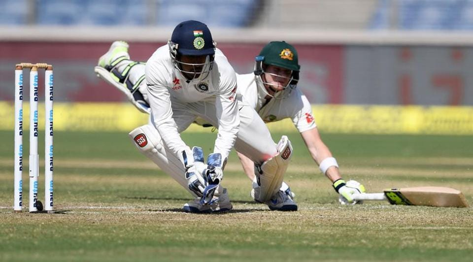 India's Wriddhiman Saha in action against Australia in the first Test match in Pune.