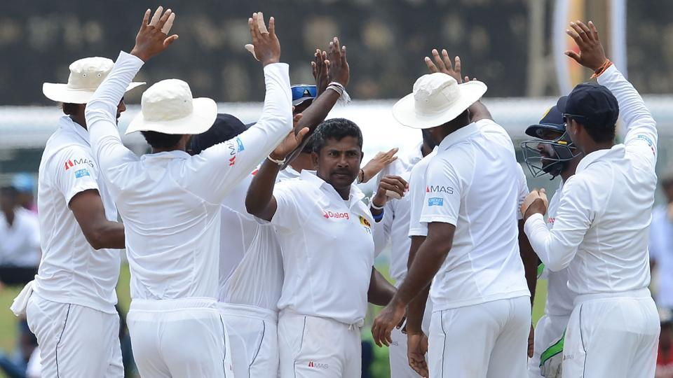 Sri Lankan cricket team players congratulate Rangana Herath (centre) after he dismissed Bangladesh national cricket team player Liton Das during the final day of the first Test at the Galle International Cricket Stadium on Saturday