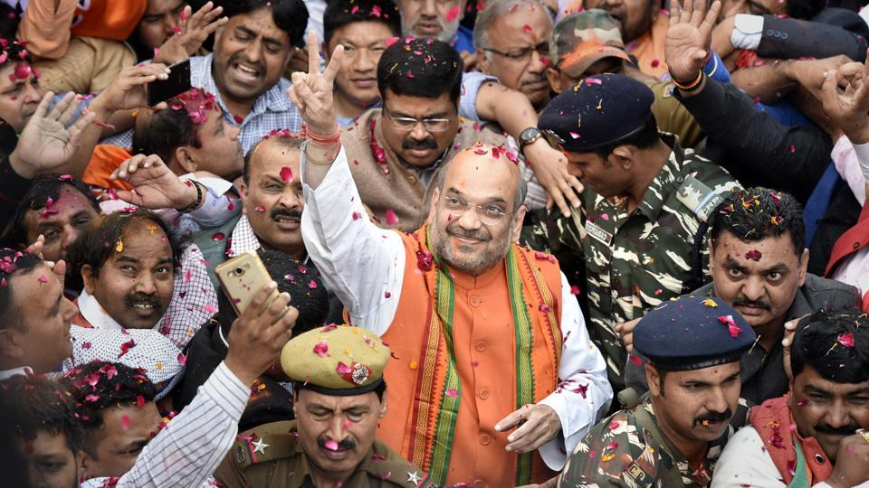 Bharatiya Janata Party chief Amit Shah arrives at the party headquarters on Ashoka Road in New Delhi on Saturdayto address a press conference on winning UPand Uttarakhand state elections. (Mohd Zakir/HT Photo)