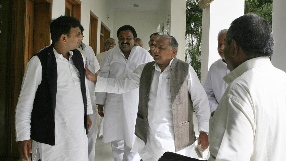 Samajwadi Party Leader Mulayam Singh Yadav with his son Akhilesh Yadav after election result in Lucknow in 2012. (HT Photo)