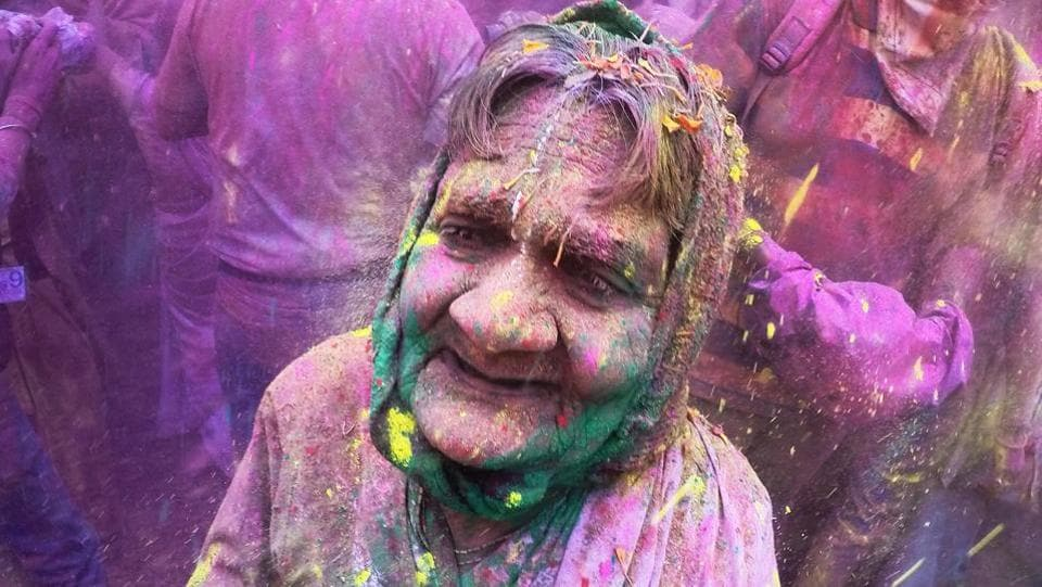 A widow  during celebrations for Holi, the Festival of Colors, at Gopinath temple in Mumbai (Pratik Chorge/HT Photo)