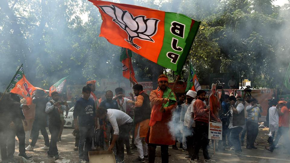 Bhartiya Janata Party (BJP) supporters celebrate elections results outside the party headquarters in New Delhi on Saturday as PMNarendra Modi looked set to tighten his grip on power with early trends showing his party leading in the key battleground of Uttar Pradesh.