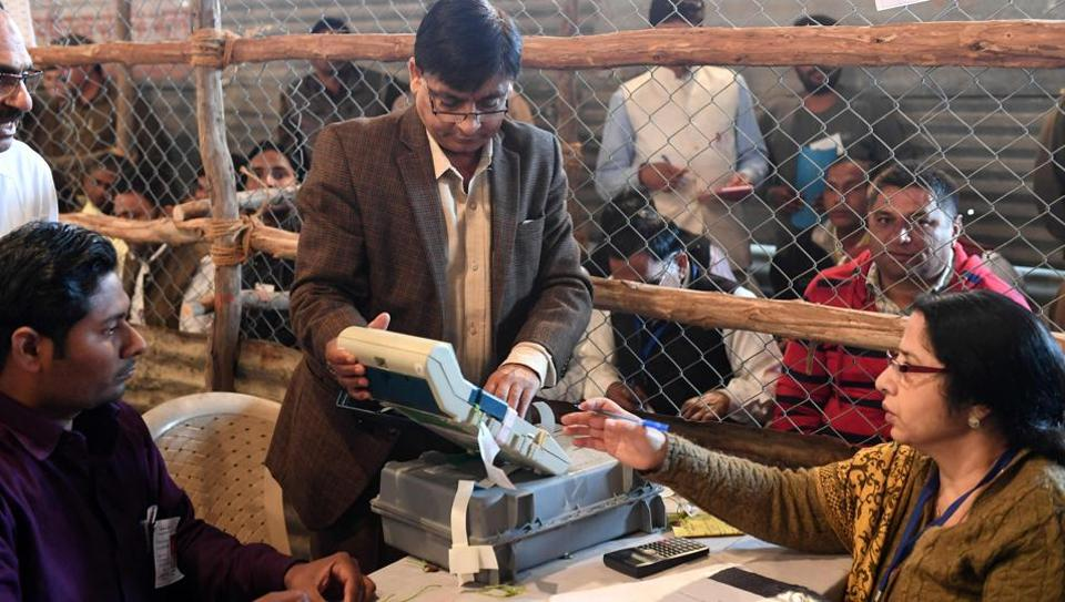 Election official shows an open Electronic Voting Machine (EVM) to political agents at a counting centre in Ghaziabad, Uttar Pradesh, on March 11, 2017.