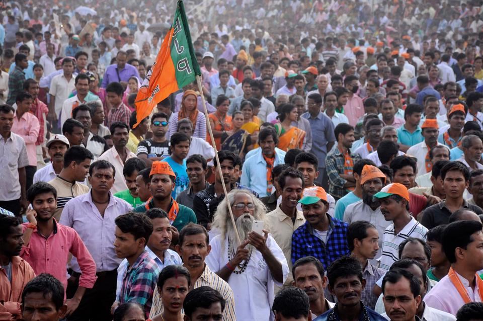 In thi spicture taken on March 10, 2017, Indian supporters of the Bharatiya Janata Party (BJP) attend a mass protest rally against the murder of senior BJP leader Chan Mohan Tripura in Agartala, the capital of the north-eastern state of Tripura. India's Prime Minister Narendra Modi will be hoping to tighten his grip on power on March 11 when results are announced from a string of state elections, including the key battleground of Uttar Pradesh. / AFP PHOTO / Arindam DEY