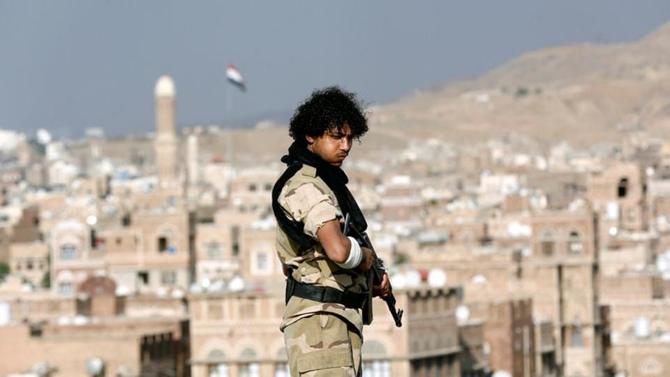 A Houthi militant stands guard on the roof of a building overlooking a rally attended by supporters of the Houthi movement in Sanaa, Yemen March 3, 2017.