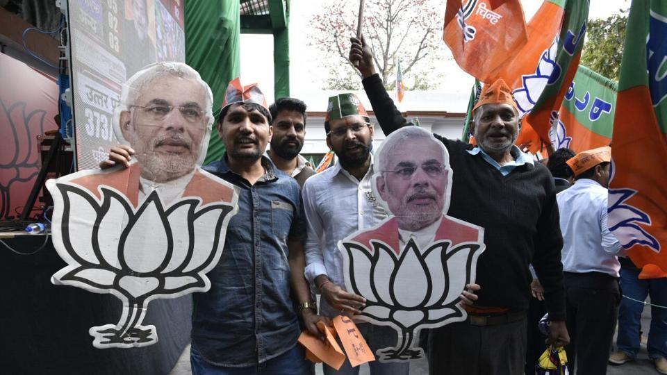 Jubilant BJP workers and supporters at party headquarters in New Delhi. (MOHD Zakir/HT Photo)