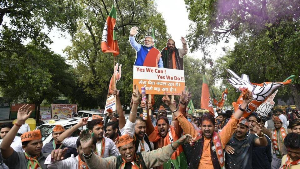 BJP supporters at the party headquarters in New Delhi. (Mohd. Zakir/HT Photo)