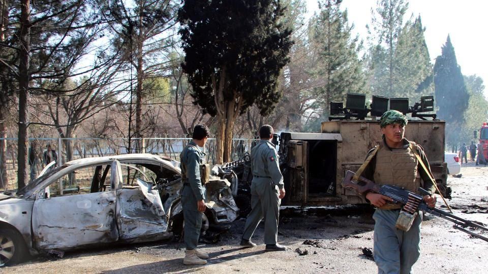 File photo of Afghan policemen inspecting  a damaged army vehicle after a suicide attack in Lashkar Gah, Helmand province, Afghanistan February 11, 2017.