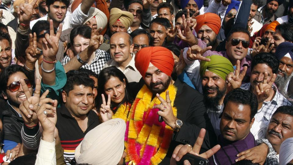 Amritsar MP Navjot Singh Sidhu along with his wife and newly elected BJP MLA from Amritsar east Navjot Kaur Sidhu celebrating the performance of their party in Punjab assembly polls on March 6, 2012 in Amritsar. (Munish Byala/ht photo)
