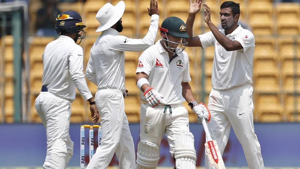 Ravichandran Ashwin, right, celebrates with teammates the dismissal of David Warner on Day 4 of the second India vs Australia Test in Bangalore on March 7, 2017.