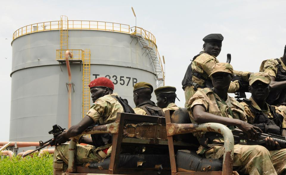 Security forces patrol near an oilfield in South Sudan's Upper Nile State.