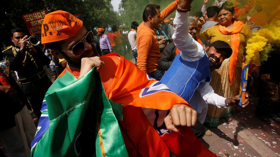 BJP workers celebrate outside the party headquarters in New Delhi, March 11, 2017