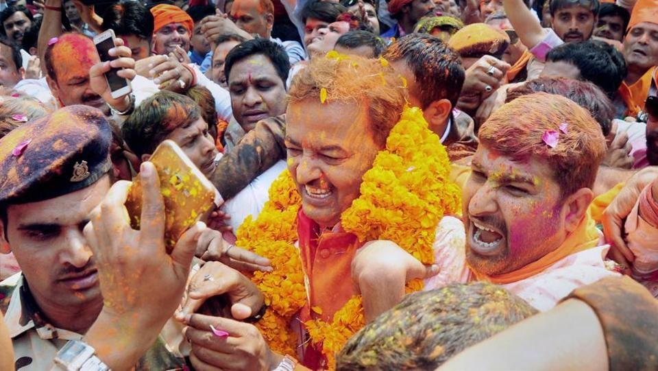Uttar Pradesh BJP president Keshav Prasad Maurya celebrate with supporters as the early trends show the party's gargantuan victory in the state assembly polls, at BJP office in Lucknow on March 11.