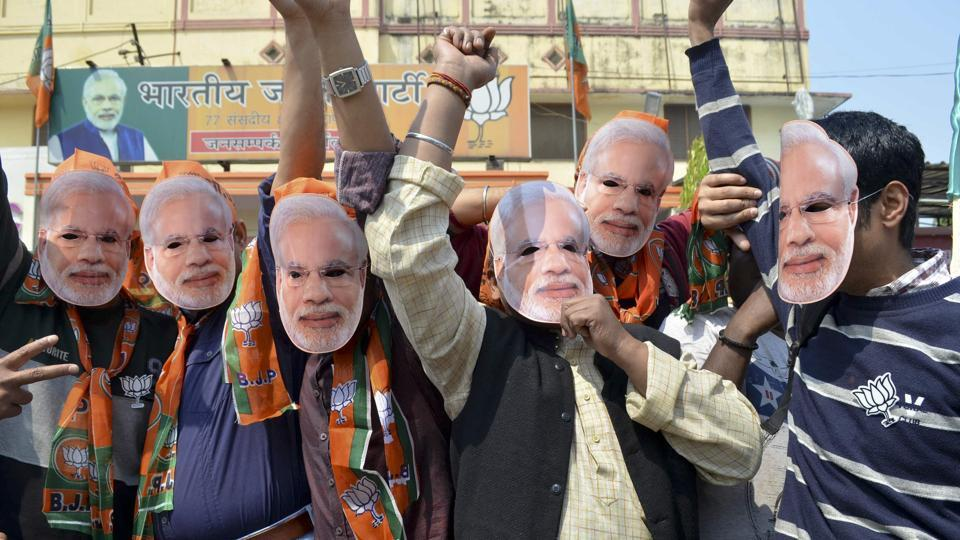 BJP's workers celebrate at the party's public relations office in Varanasi on Saturday.