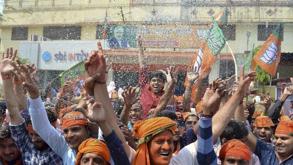 BJP workers celebrate victory at party office in Varanasi. (Adarsh Gupta/ht Photo)