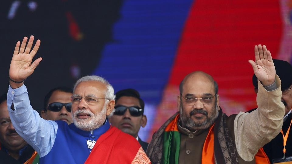 The credit for the sweeping victories in Uttar Pradesh and Uttarakhand will be given to Prime Minister Narendra Modi (L) and BJP chief Amit Shah.