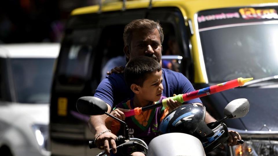 A child plays with a water gun at Parel on Saturday.