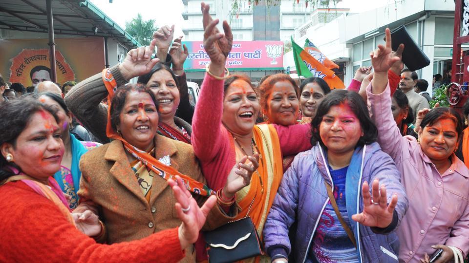 Women celebrate the BJP's victory in Dehradun.