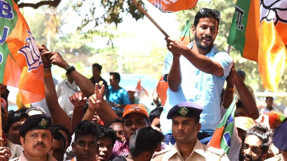 BJP supporters celebrating outside a counting centre in Panaji after announcement of election results on Saturday.