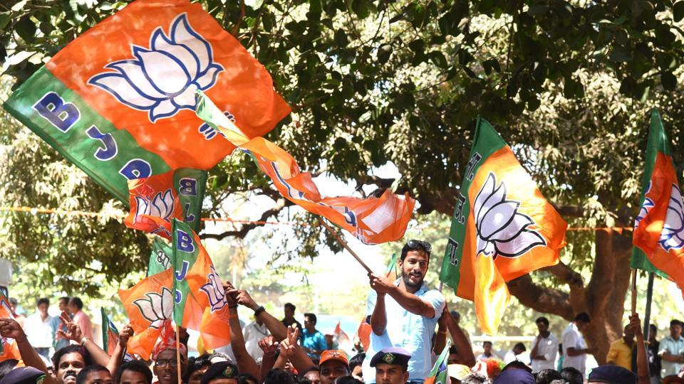 BJP supporters celebrate outside counting centres in Panaji, Goa, on Saturday