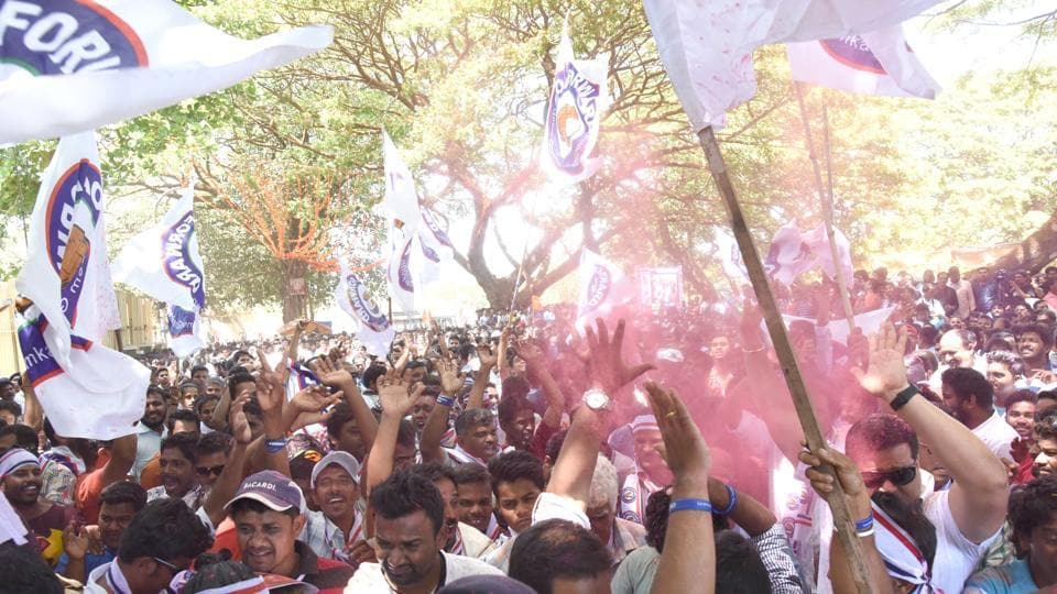 Supporters of Goa Forward candidate celebrate outside a counting centre in Panaji on Saturday.