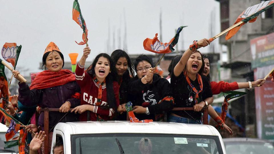 BJP supporters  in Imphal celebrate their party candidate's  win  in assembly elections on Saturday.