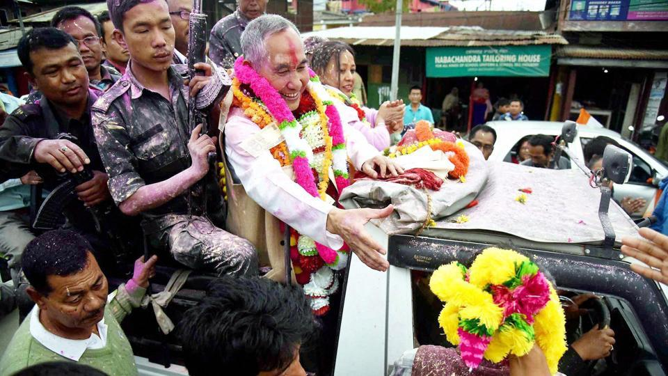 National People's Party candidate and former Manipur DGP Y Joykumar celebrates after winning the Uripok constituency in Imphal on Saturday.