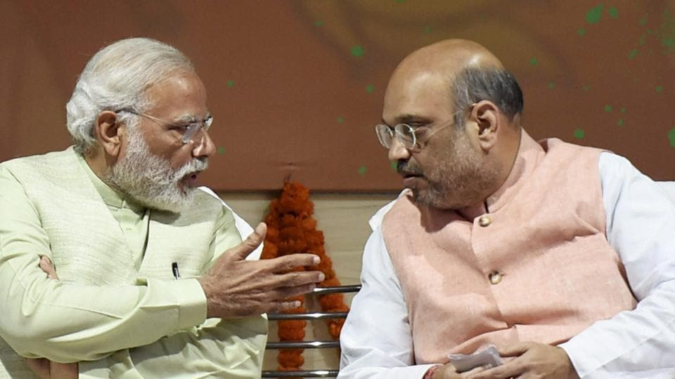 Prime Minister Narendra Modi and BJP president Amit Shah at the party headquarters to celebrate victory in UP and Uttrakhand Assembly elections, in New Delhi on Sunday.