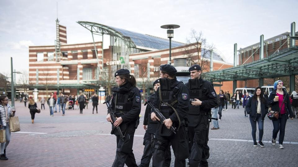 Armed police guard near the shopping mall 'Centro' in Oberhausen, Germany. Police in the area have increased security measures after police have ordered a shopping mall in the western German city of Essen not to open Saturday after receiving credible tips for an imminent attack.