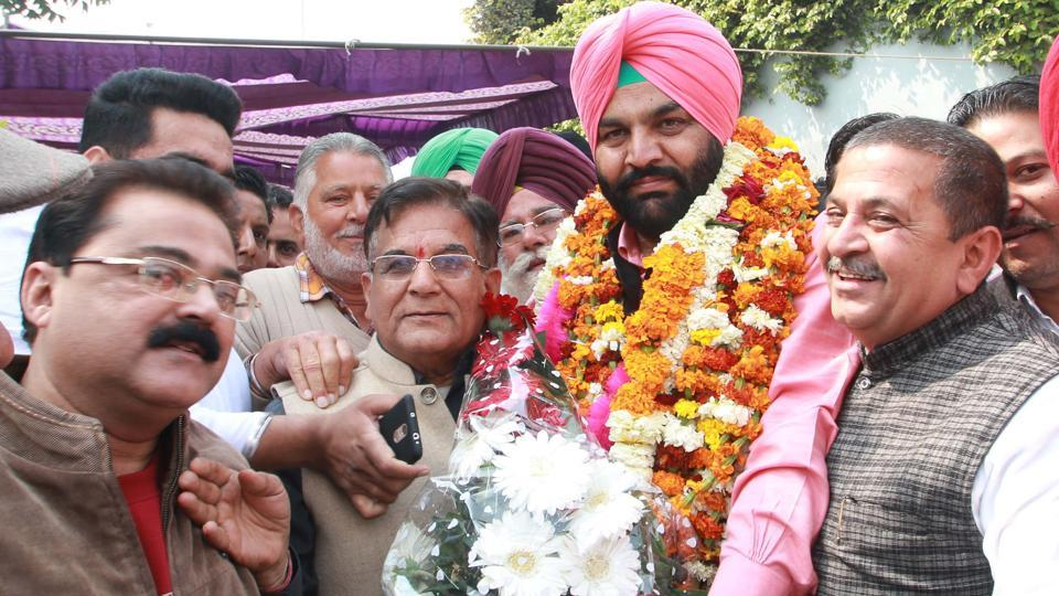 Gurjit Singh Ajula celebrating his victory in Amritsar on Saturday.