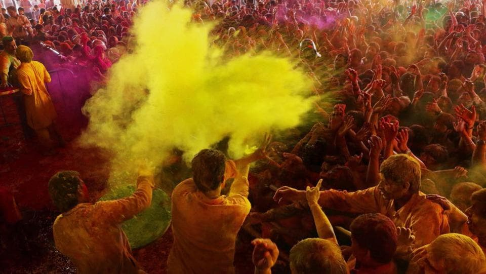 Devotees playing with colours  at historical Govind Dev Ji temple in Jaipur . The streets and lanes across most of India have turned into a large playground where people of all faiths throw colored powder and water at each other. (PTI)