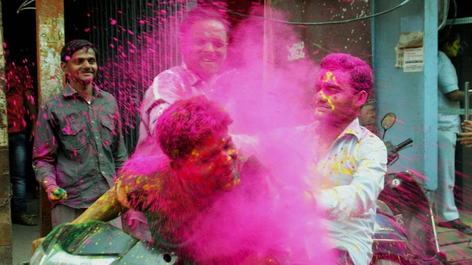 College students play with powdered colour as they take part in Holi festival celebrations in Lucknow . (Nand Kumar/ PTI)