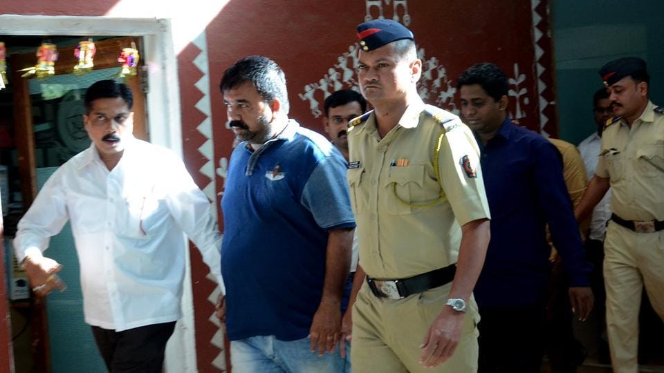 Policemen with one of the eight accused at the court in Vashi on Saturday.