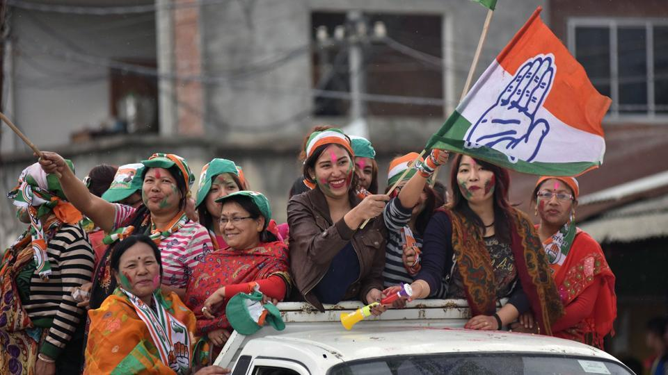 Supporters of the Congress party  wave their flags as they celebrate their candidate's win in state assembly elections in Imphal.  (Biju BORO / AFP)