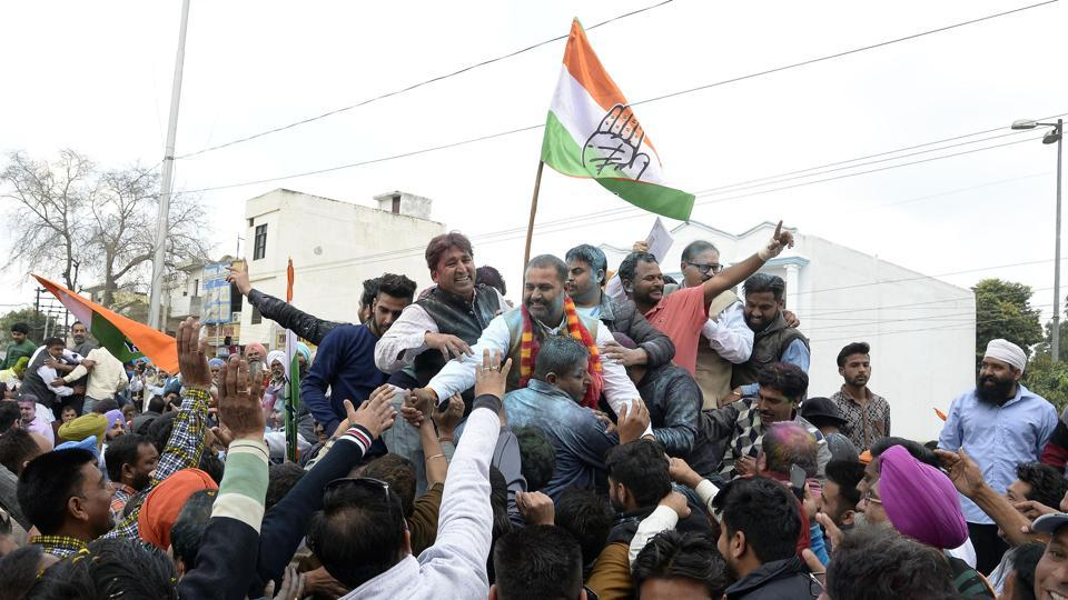 Indian Congress Party candidate for the Jalandhar West constituency Sushil Rinku (C) greets supporters after his win in Jalandhar on Saturday.